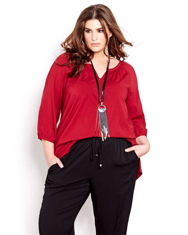 With its flowing lines and tunic silhouette, this top has the boho chic vibe everyone's coveting this season. Plus size, scoop neck with V nock, faggoting at the neck and centre front. Rounded shirt tail hem. 33 inch length.