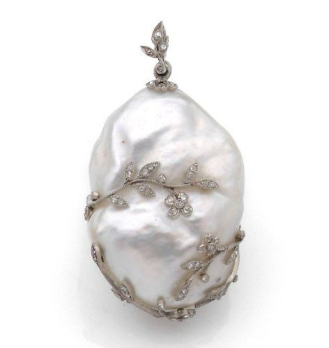 Lovely blister pearl pendant from the 1920s mounted in platinum decorated with fine branches set with rose cut diamonds.