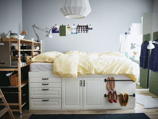 A close up of tiny drawers on a platform bed