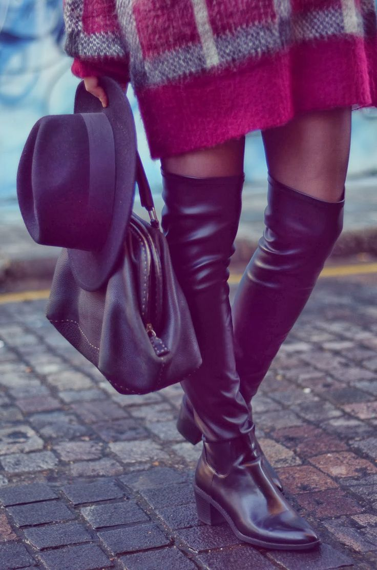 Black thigh over-the-knee boots and a jumper dress