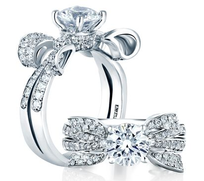 From the Seasons of Love Collection, this bow inspired diamond ring is not your ordinary sparkler. This ring makes a statement as a piece of wearable art.