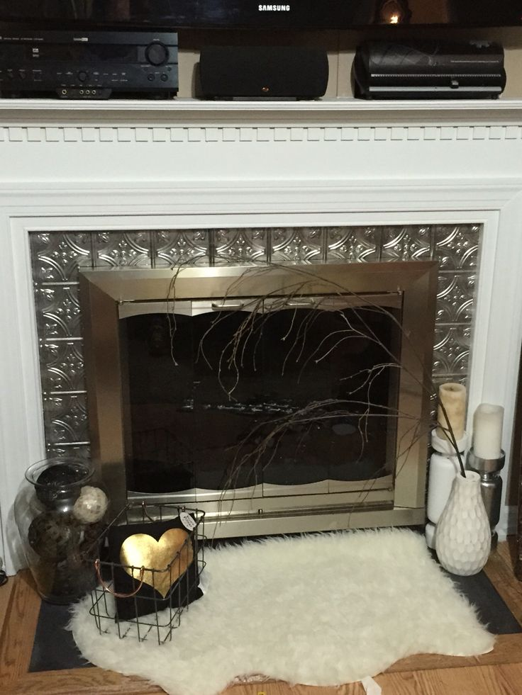 Faux Metal Tiles Around Fireplace, Can You Tile Over Metal Fireplace Surround