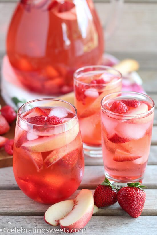 Peach Rosé Sangria Recipe - Rosé, peach juice, peach liqueur, and fresh fruit combine in this beautiful sangria! Perfect summertime beverage!