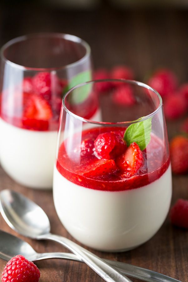 This Panna Cotta with berry sauce is AMAZING! A quick and easy recipe that can be made in advance (perfect for entertaining!) The secret ingredient... | natashaskitchen.com