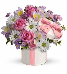 Make the merry month of May extra merry for Mom with lovely pink, white and purple flowers in a charming ceramic hat box topped with a pink ribbon