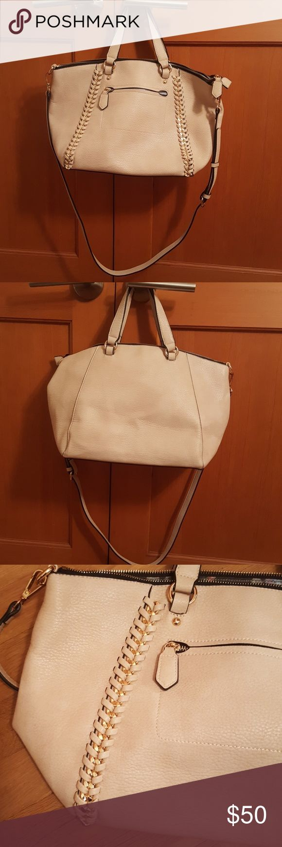 Gabriella Rocha medium beige satchel Gabriella Rocha medium beige satchel with gold chain decal and gold hardware. Comes with removable strap to convert to a shoulder or cross body bag. This item is brand new without tags and has never been worn before. In perfect condition! Handle and zipper lining is black. Gabriella Rocha Bags Satchels