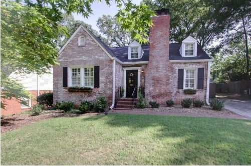 Love the brick peaking through the faded white black - Exterior house washing charlotte ...