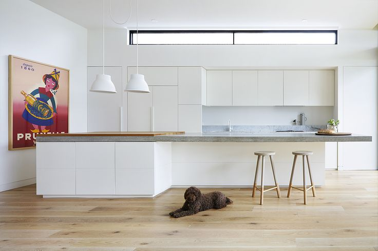 Highlight window above kitchen cabinetry - could be a way to cast light into our laundry on the other side (Pipkorn & Kilpatrick Interior Architecture)