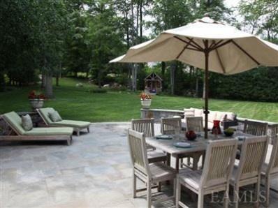 Exterior back patio and backyard