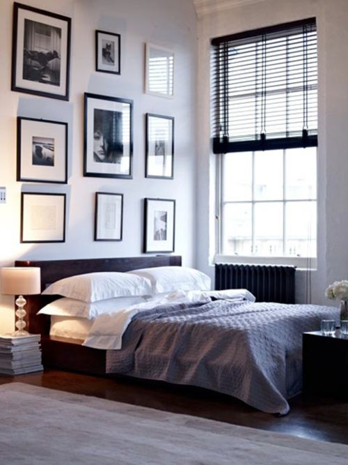 Beautiful bedroom with black, white, and grey as base colours. I love the black picture frames, and the colour on the floor