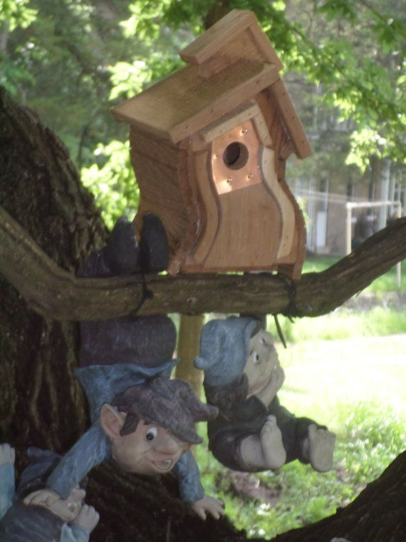 Copper around entrance hole to keep other animal from enlarging the hole. This bird house is made of Cedar so it can be used inside as a decorative piece or outside as a home for Wrens. It measures 8 inches tall by 6 inches wide with a depth of 6 inches. It is assembled with