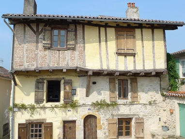 4 Rue du Fort, Limousin, Central France  A restored French medieval townhouse, dating back to the 15th century, in Bellac. Retaining original features including a staircase over 500 years old, late medieval floor tiles and cut granite fireplace. Home to a traditional full French 'box bed'.