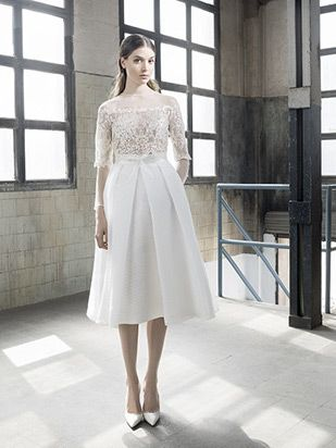 Harper Delante from Inmaculada Garcia wedding dresses 2016 -Below the knee full skirt with a small belt around the waist. High sheer neckline with 3/4 length sleeves and fine embroidery - see the rest of the collection on www.onefabday.com