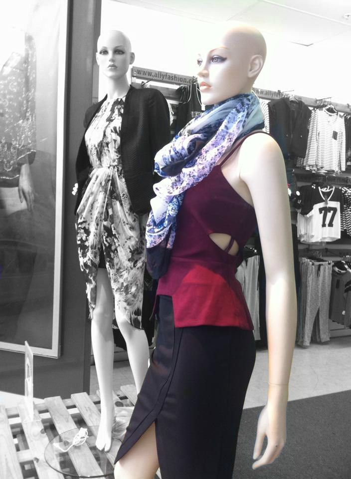 Maroon and the peplum style are also very 'in' this season. Add a light patterened scarf to break up the block colours.