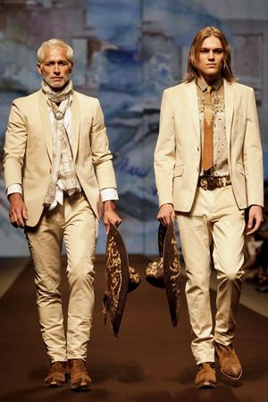 With Santana songs blasting, and straw sombreros, bullet holsters and hot leather pantstrottingdown the runway, Etro provided the theatrical high-point of the entire day. The only thing that was ...