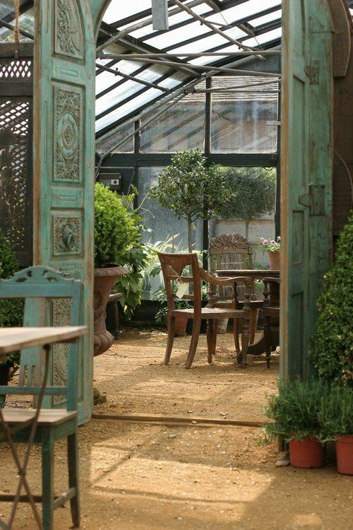 love the idea of a table inside. Just to sit and 'smell the rose'(s), what a great idea!