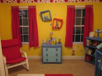 The Topsy Turvy Wall Plates Decorate The Wall Between The Red Curtain  Panels In Our Baby
