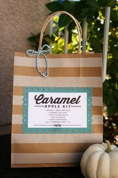 Caramel Apple Kit Gift idea with free print on { lilluna.com } A great gift full of apples, caramels, toppings, lollipop sticks, everything for the yummiest snack!