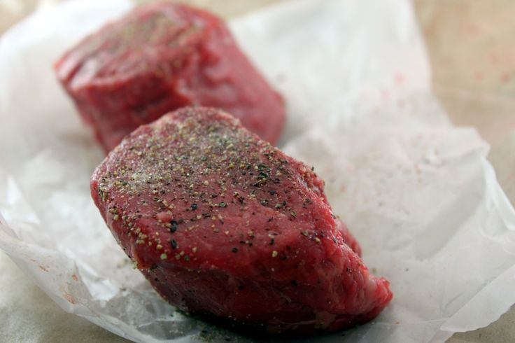 Restaurant Style Filet Mignon 2 8 ounce filet mignons4 teaspoons kosher salt4 teaspoons freshly ground pepper1 stick butter1 tablespoon olive oil2 cloves garlic1 tablespoon parsley, chopped1 tablespoo