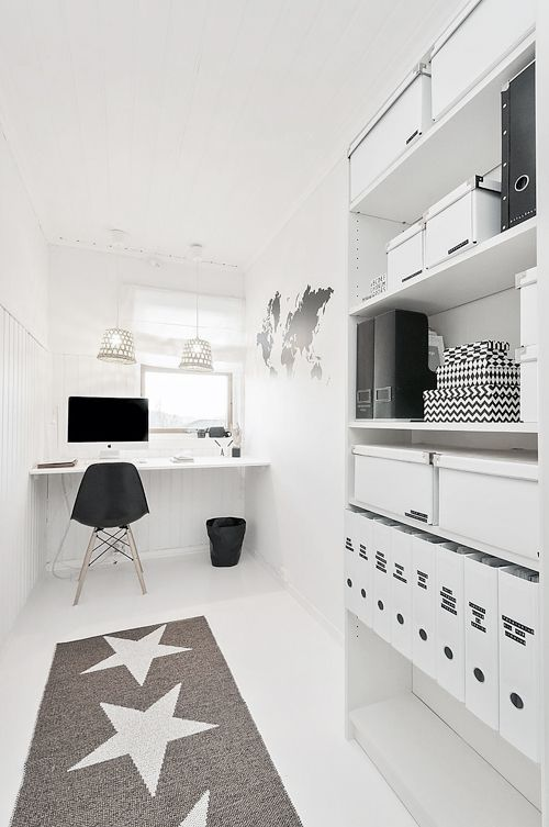 Perfect work room. Stars on the ground, the world on the wall and all is black & white!