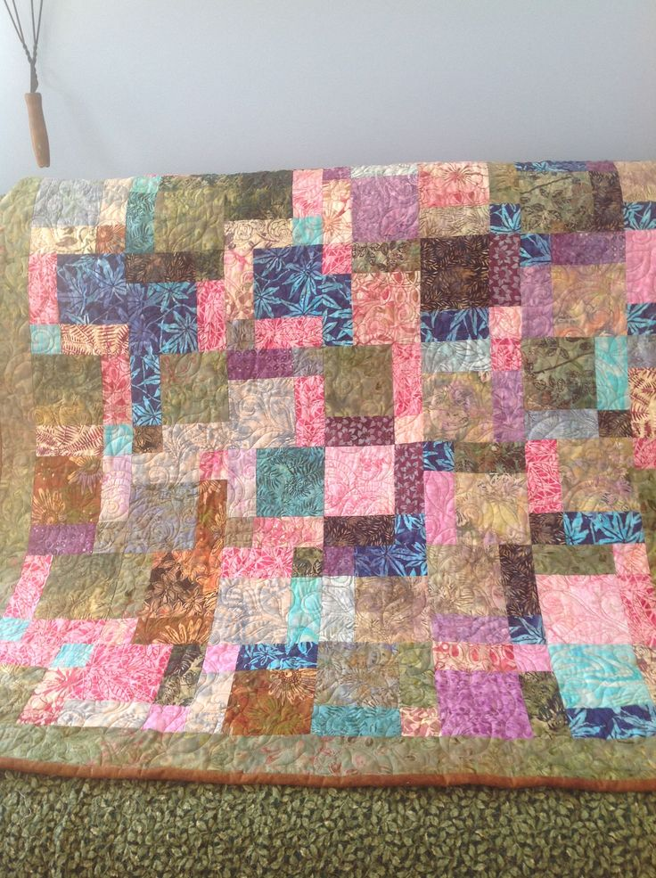 Quilted disappearing 9 patch with batiks