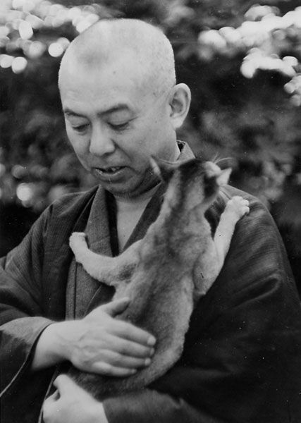 """Junichiro Tanizaki (Who write"""" In Praise of Shadows"""" that critic about lighting in Japanese house) and kitty. Kitty makes up for hair loss."""
