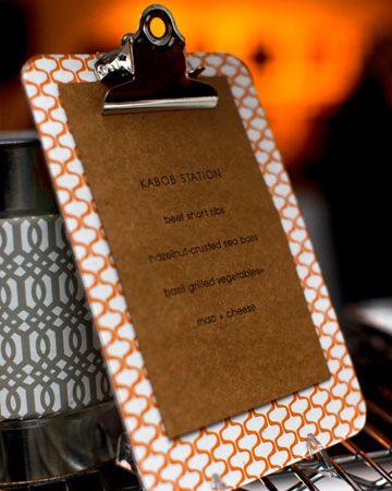 Display kraft-paper menus on mini clipboards for an industrial or modern feel