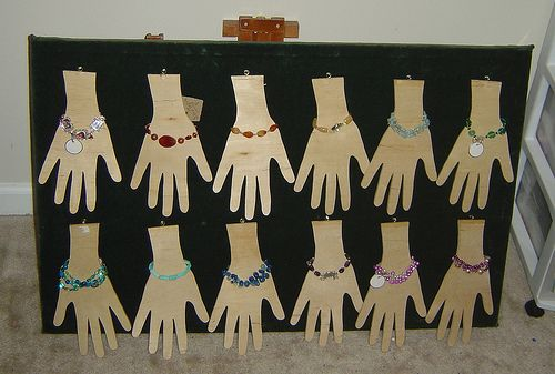 bracelet displays... This would be cute if we traced the kids hands and put the bracelets they make on display for a little bit before sending them home!