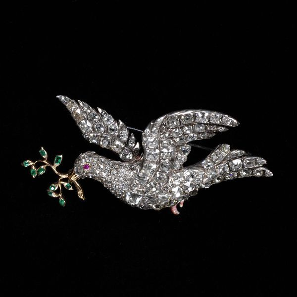 A French diamond, emerald, ruby and silver brooch, c.1755, in the form of a dove holding an olive branch, a symbol of peace. (Victoria & Albert Museum)