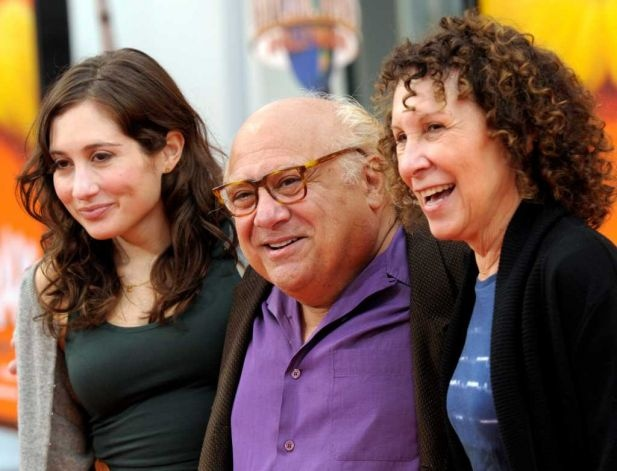 Actor Danny DeVito, center, his daughter, actress Lucy DeVito, left, and wife, actress Rhea Perlman (2012)