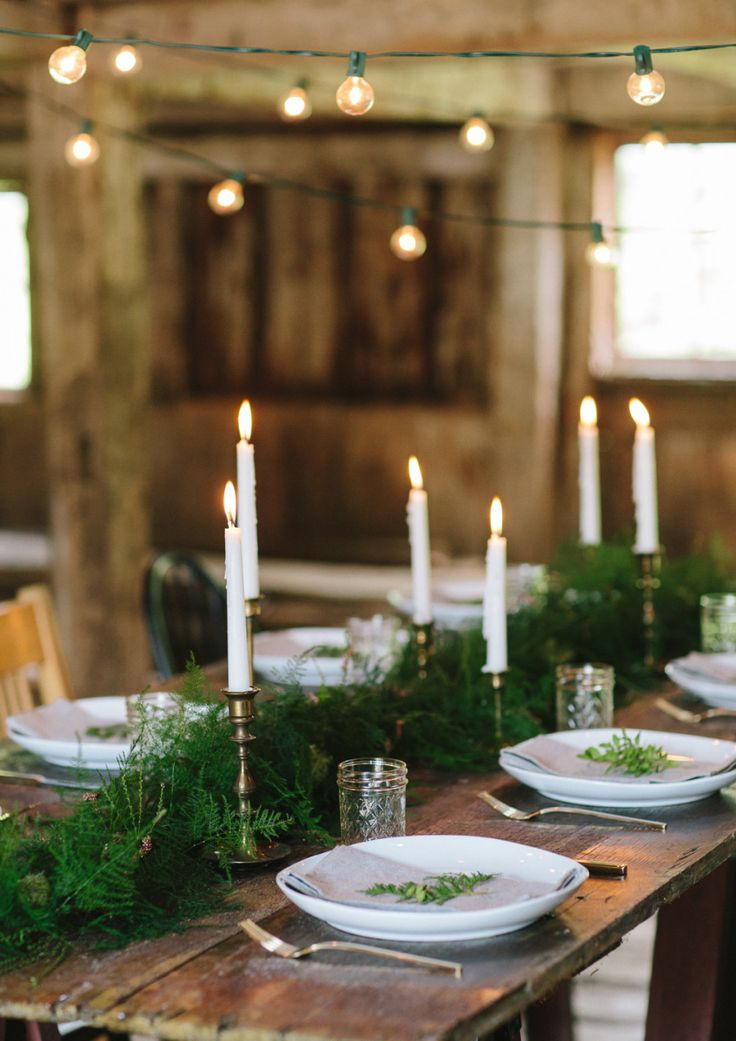 Simple greenery runner and brass candlesticks via @zsazsabellagio #WilliamsSonoma #holidaystyle