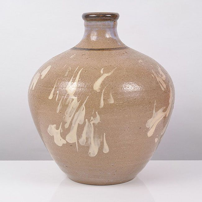 HEBER MATTHEWS, British, 1905-1959, Large Bottle Vase, circa 1945, stoneware, thick cream slip splashes beneath a transparent glaze with pale purple splashes, an iron band around the neck and lip, incised HM mark, H 30cm, D26 cm. Provenance: private collection