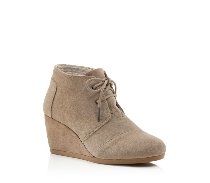Classic suede desert booties get a lift with these just-the-right-height wedges from Toms. | Suede upper, canvas lining, rubber sole | Imported | Fits true to size, order your normal size  | Available