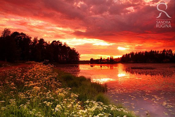 Dramatic sunset in Finland over a lake surreal by behindmyblueeyes