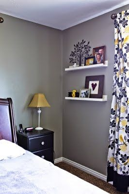 Picture ledges in gray and yellow room