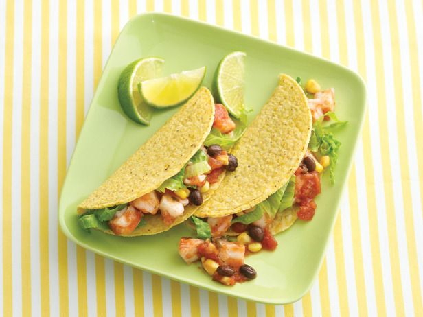 Shrimp cocktail tacos! Crunchy Taco Tip: Line taco shells with lettuce leaves to create a barrier between the wet filling and crunchy shell.