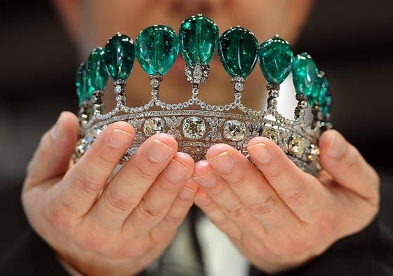 Over 500 carats of Colombian emeralds set in a tiara with antique cushion cut diamonds.