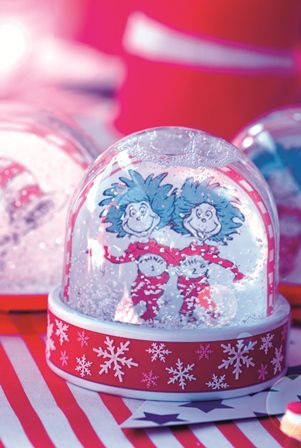 Cat in the Hat party: Personalised snow globes make perfect party décor and take-home gifts. Insert colour-copied images.