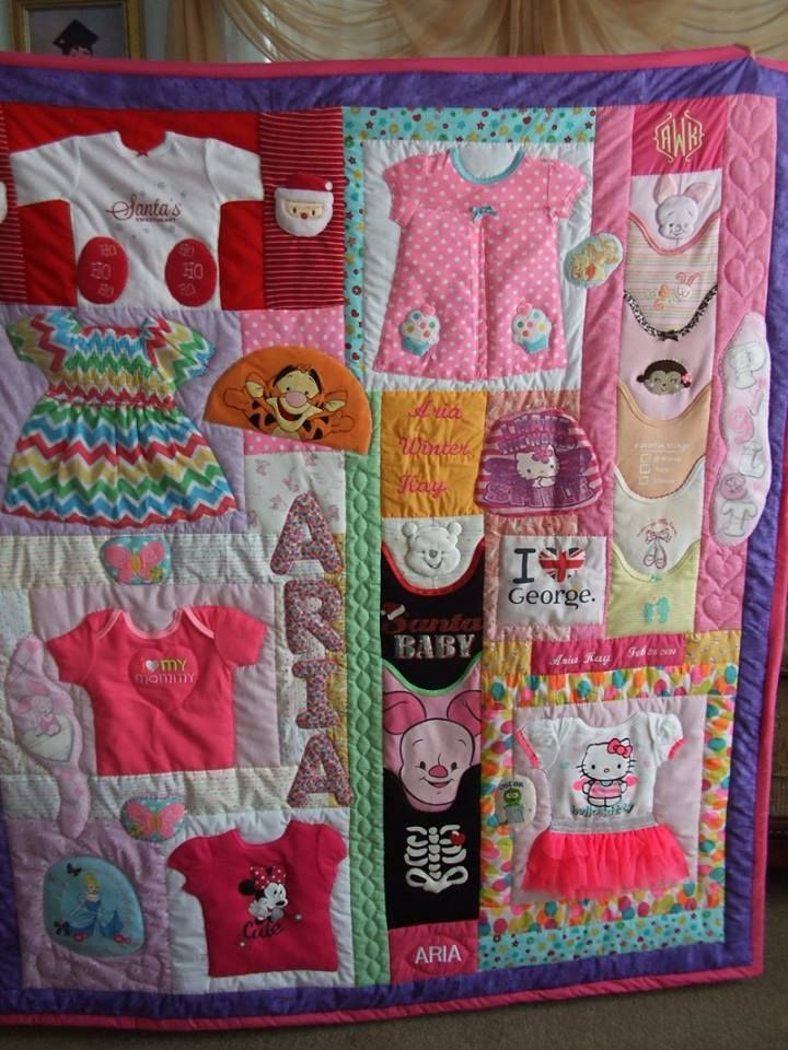 Quilt made with some of my grand daughter's first year clothes.colcha hecha con algunos de los primeros años la ropa de mi nieta