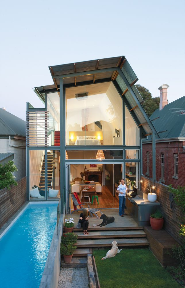 A tiny home with everything you need: fireplace, pets, loft bed, a lawn, sunshine, a pool, and love. Click for the article. You wouldn't believe what the front of the house looks like!