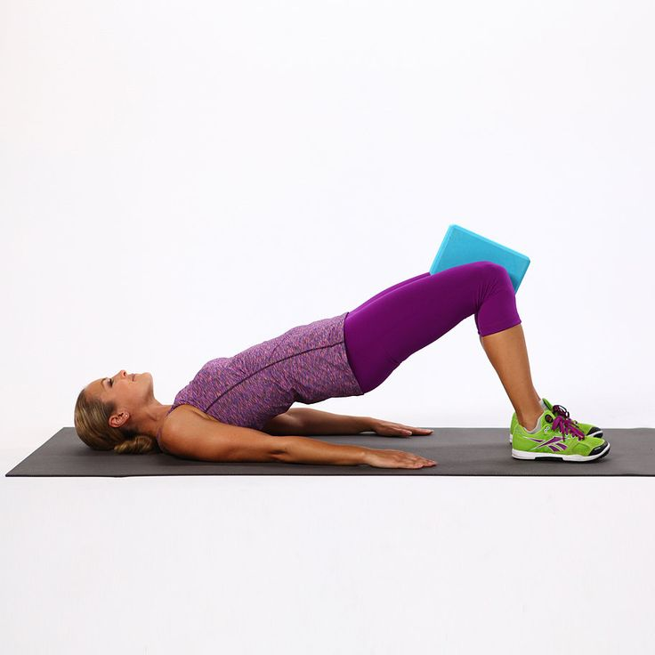 Adding an inner-thigh squeeze to your basic bridge will tone your inner thighs.   Start on your back with your knees bent and your feet hip distance apart. Place a pillow, a ball, or a toning ring between your knees. Push up into a bridge. Keep your ribs aligned with your pelvis. Without raising or lower your pelvis, slowly squeeze your pillow 20 times. Lower the pelvis and bring your knees to your chest to round and relax your back. Then repeat twice for a total of three sets.  Source: ...
