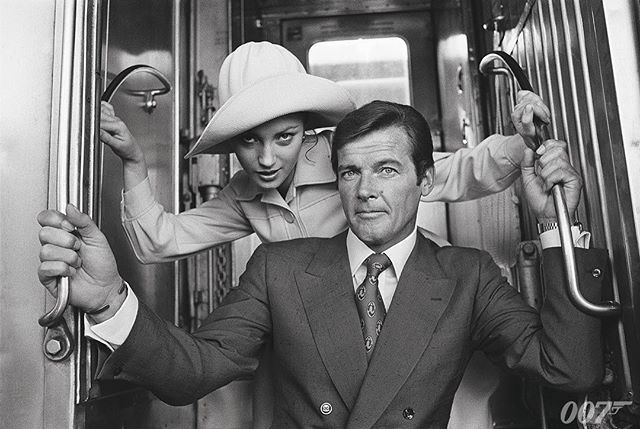 Roger Moore (Bond) and Jane Seymour (Solitaire) pose on the train steps at Union Passenger Terminal, New Orleans, Louisiana while shooting LIVE AND LET DIE (1973)