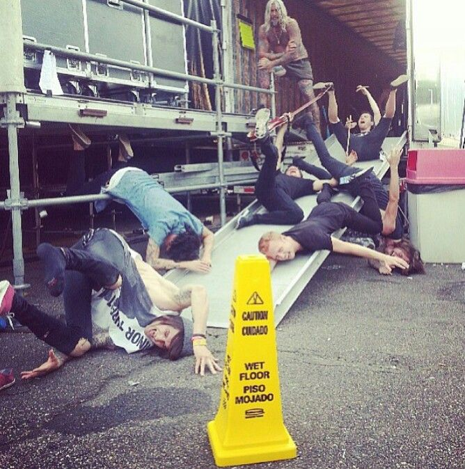 To make this better, any time this band, blessthefall see a wet floor sign they have to all drop to the group like they fell and take a picture.