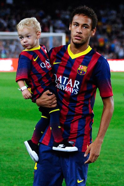 Neymar of FC Barcelona with his son davi Lucca walk out the pitch prior to the La Liga match between FC Barcelona and Real Sociedad de Futbol at Camp Nou on September 24, 2013 in Barcelona, Catalonia.