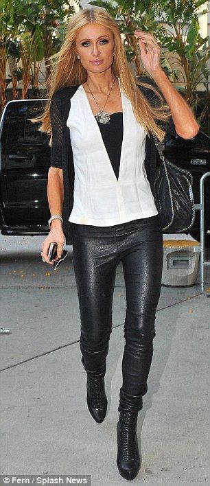 Stylish touch: Paris paired the trousers with pointy black leather boots, a white top and black blazer