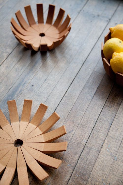 Modern wooden fruit bowl.