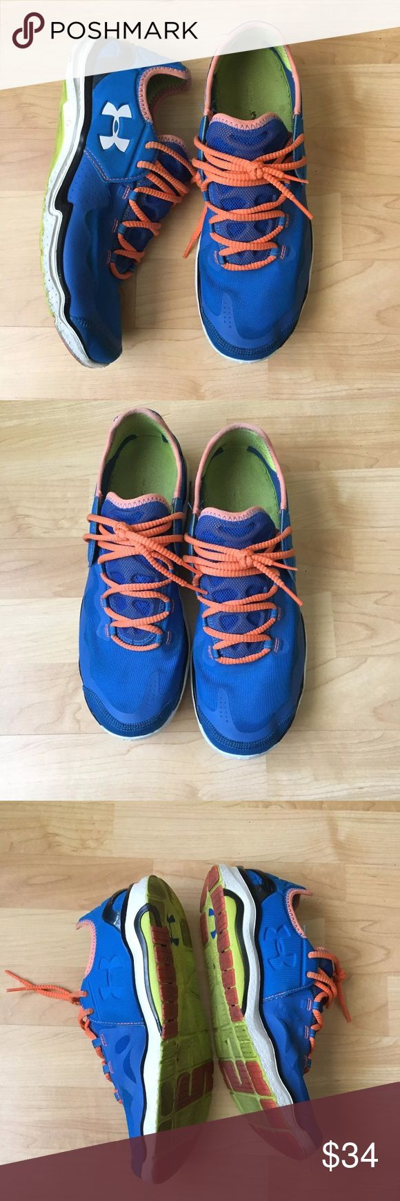 Under Armour Men's Blue Micro G Sneakers Size 11 For Sale is this Pair of Under Armour Micro G Running Shoes in a size 11. These shoes are blue with orange laces. Road-ready and engineered for speed. Up top there's light, breathable HeatGear fabric for keeping your feet dry during hot weather. Underneath you've got UA's super-responsive Micro G cushioning, which keeps you low to the ground for a more stable ride. The inter sole is the 4D Foam cushion that molds to your foot to give you a…