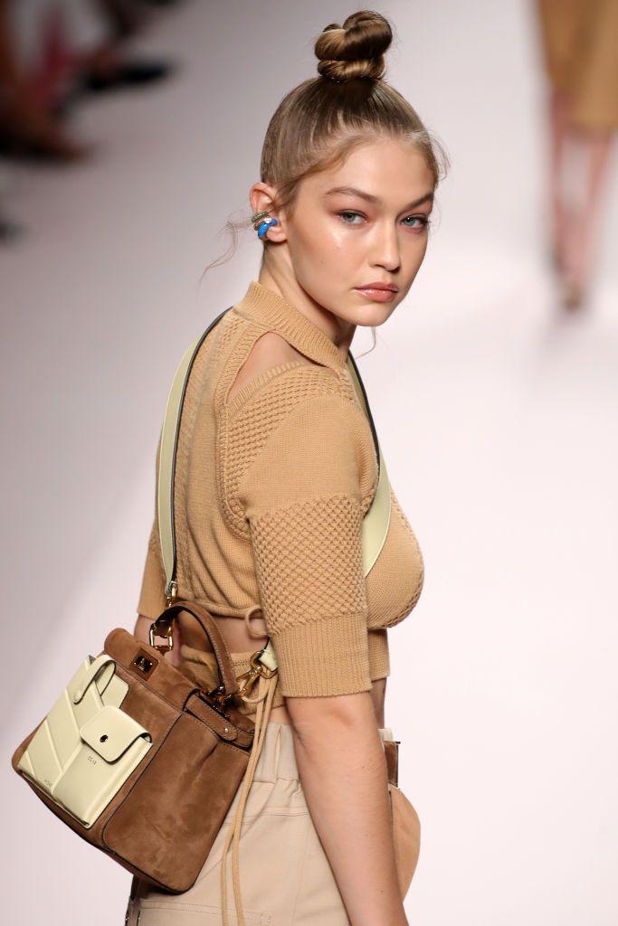 1bb81997229 Gigi Hadid walks the runway at the Fendi show during Milan Fashion...
