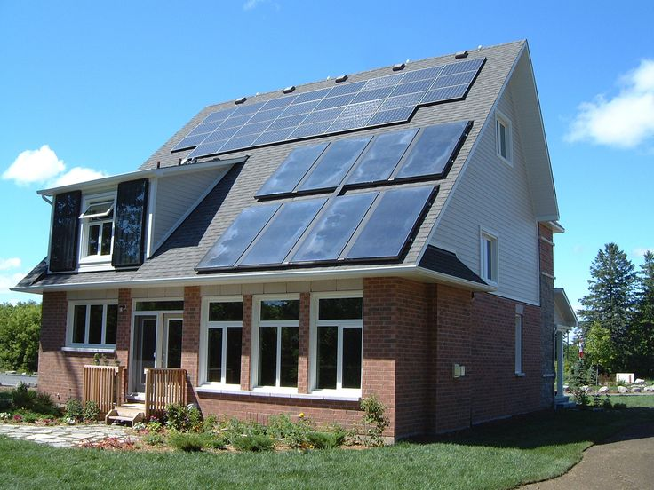 Solar PV with solar thermal (bottom right) and vertical solar air collectors for Minto demonstration home.
