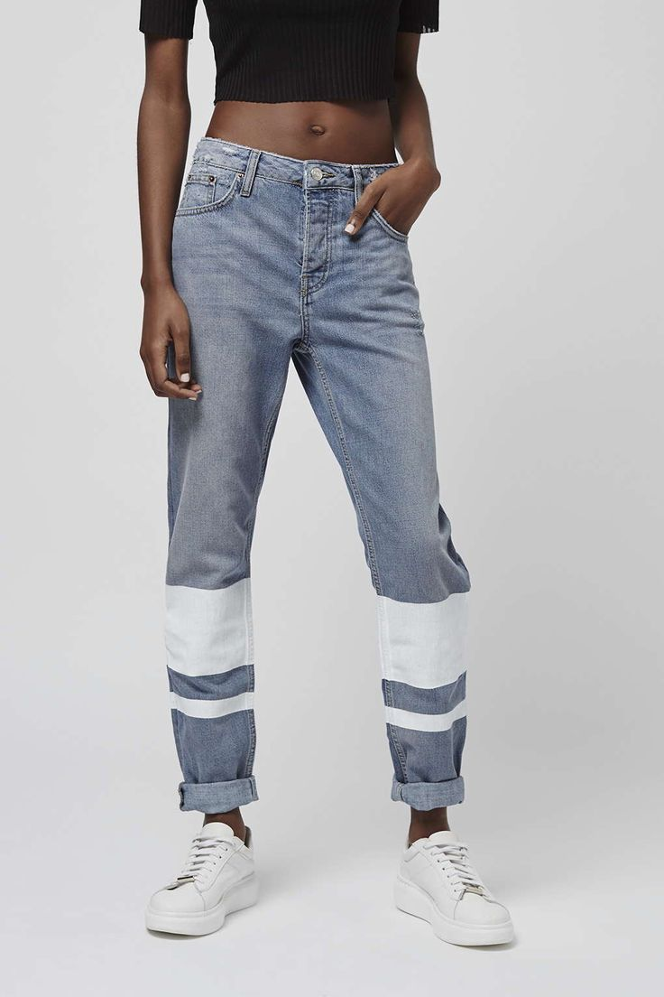 MOTO low slung boyfriend jeans in a soft blue wash. Comes with white stripe detailing for statement edge, with multiple pockets and a top button fly. #Topshop
